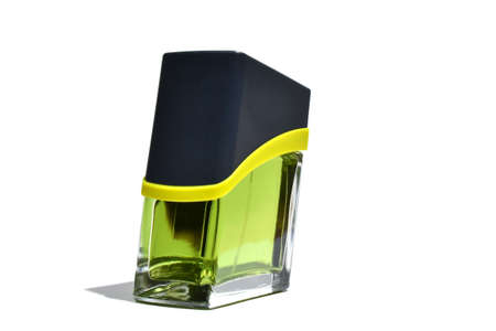green bottle of perfume with white backround photo