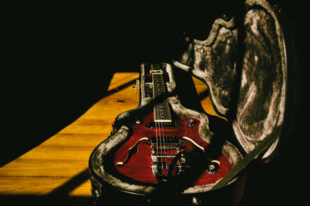 -Semi hollow guitar in the shadows. Archtop guitar in a hard case, semi hollow guitar with vibrato, electric guitar, vintage tone and blues guitar