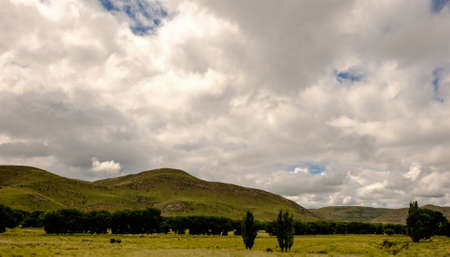 horizontals: Green mountain under storm clouds Stock Photo
