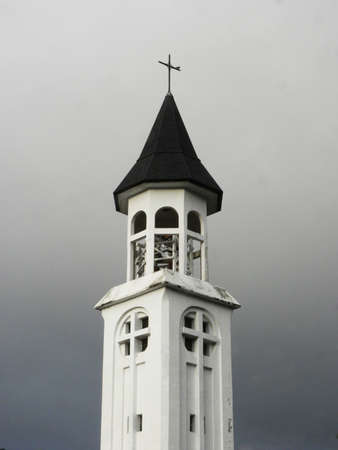 Church tower in patagonia with cast sky photo