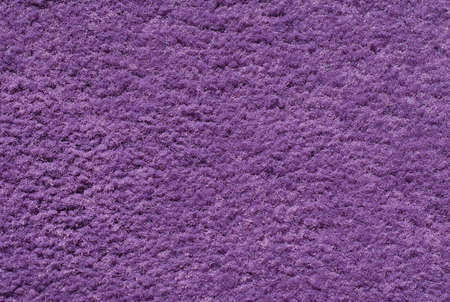 Purple wool carpet close up photo