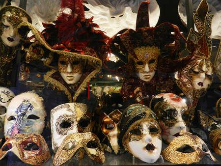 Group of venetian fancy masks in a shop window