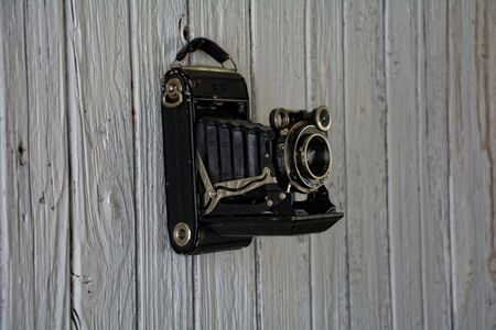 depends: old camera depends on old wooden wall Weier Stock Photo