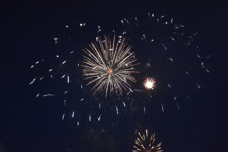 pyrotechnics: Big colorful fireworks in the black night sky Stock Photo