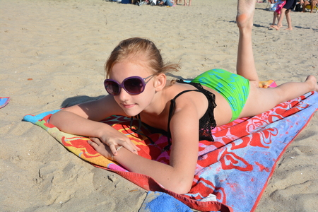 Girl is lying on the beach