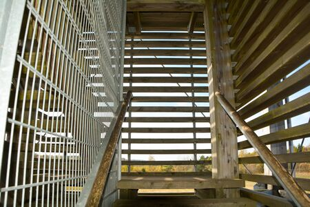 Inside - stairs in a wooden lookout tower  on a sunny day Standard-Bild