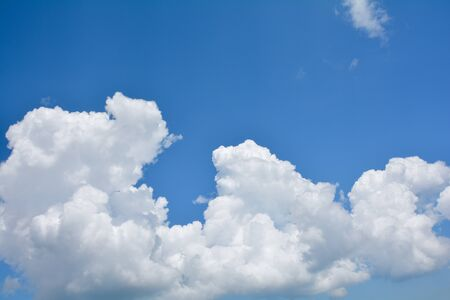 Blue sky background with white clouds and copy space Imagens