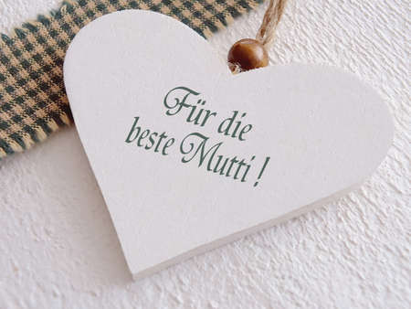 Wooden heart for mothers day with german text photo