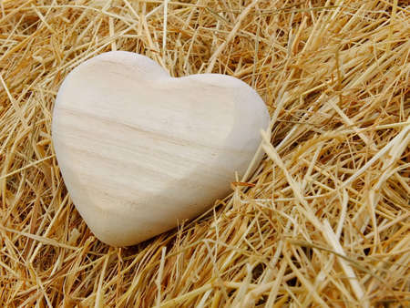 Image of a wooden heart with straw photo