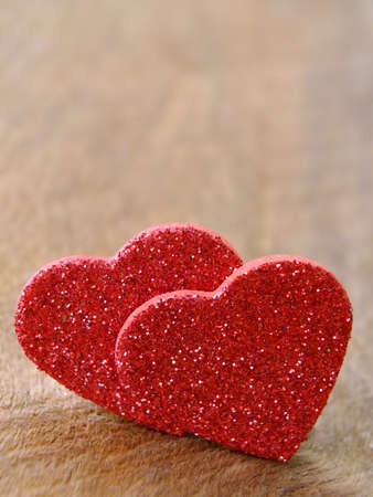 Two hearts on wooden background with copyspace