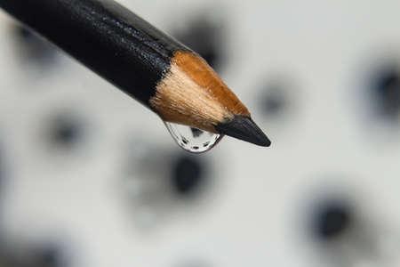 Black pencil with drop of water Banco de Imagens