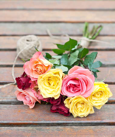 a bunch of roses on a garden table Stock Photo