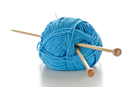 blue wool with knitting needles on white background Stock Photo