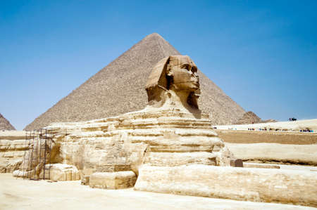 the Sphinx in front of the Piramid in Cairo, Giza, Egypt with blue sky.