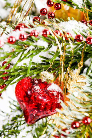 close up of a decorated christmas tree with a red heart photo