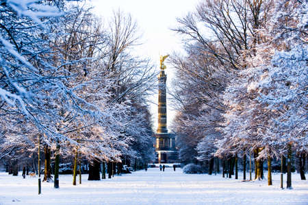 snow in a park in Berlin with view on a statue Stock Photo
