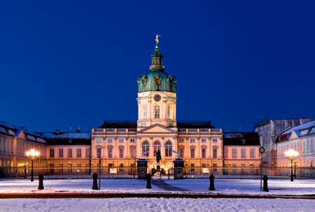 the front of Berlin castle named  Schloss Charlottenburg  in the blue hour in winter time