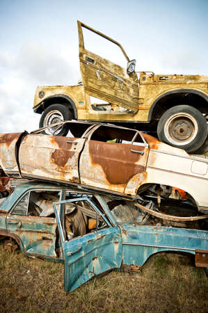 old cars at a scrapyard photo