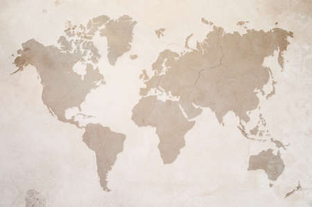 world maps: a map of the world on old wall Stock Photo