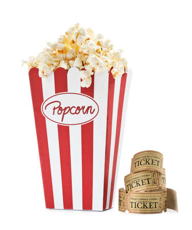 cartoon circus: a bag full of popcorn and some old cinema tickets with white background