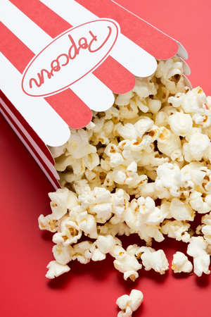 nibbles: a bag of popcorn with red background
