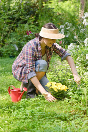 a young woman working in the garden, spring or summer time Stock Photo