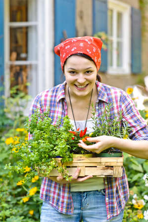 a young woman working in the garden, spring or summer time photo