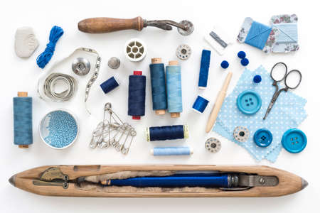 a collection needle work accessories in blue on white background photo