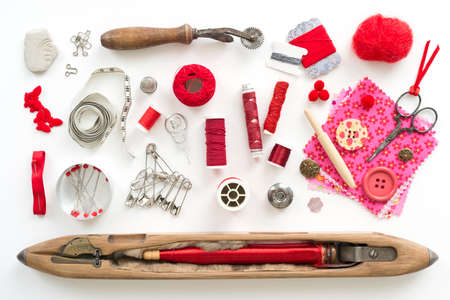 savety: a collection needle work accessories in red on white background