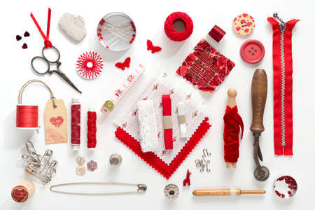 weavers: a collection needle work accessories in red on white background