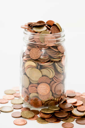 investment banking: euro cents collected in a glass jar on white background Stock Photo