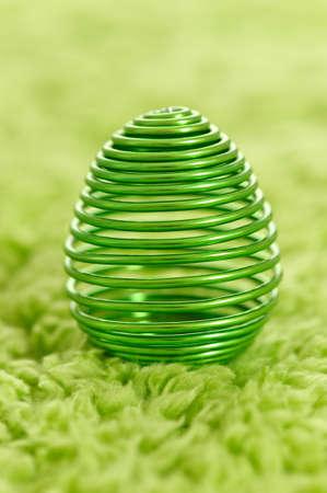 moulder: metal easter egg on grass