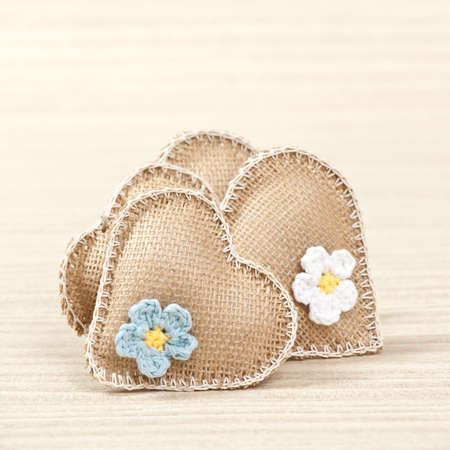 Hearts with flowers on light background photo