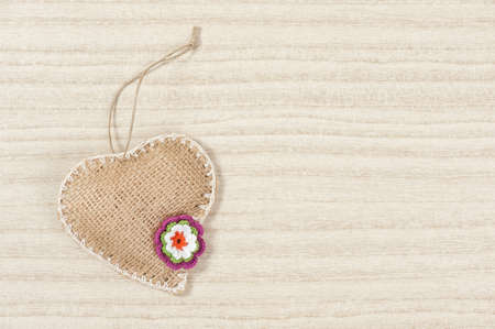 Heart with flower on light background photo