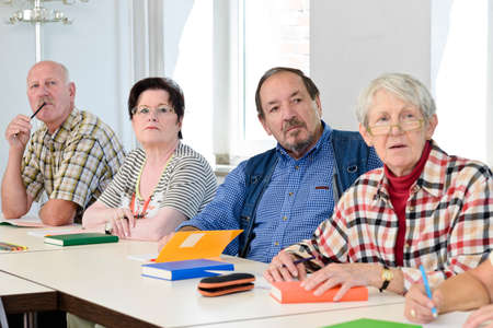 Seniors in a classroom, further education Stock Photo