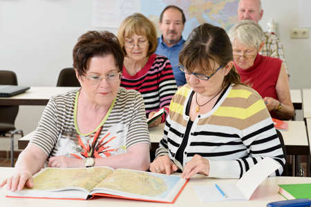 teaching adult: seniors in a classroom, further education