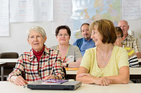 people sitting: seniors in a classroom, further education
