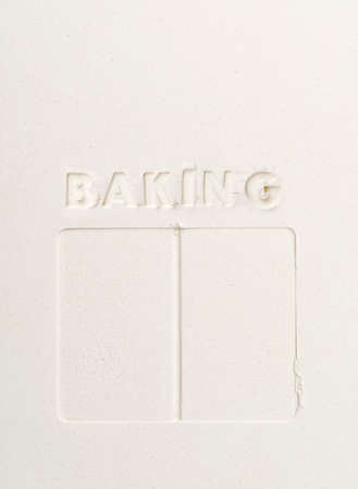 imprinted: BAKING imprinted into flour with empty book