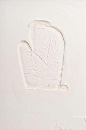 imprinted: kitchen glove imprinted into flour