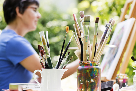 color therapy: a woman painting a picture in the garden