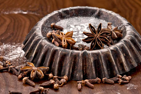christmas scent: old backing dish with flour baking ingredient on dark background