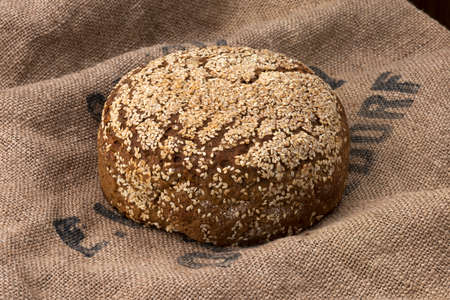 life loaf: fresh baked bread on top of a jute bag