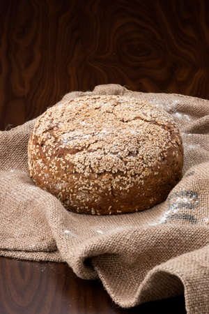 fresh baked bread on top of a jute bag