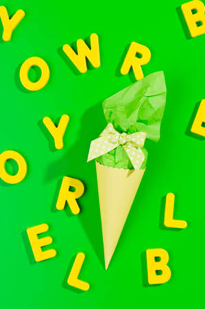 first year student: little cone present with yellow letters on green background