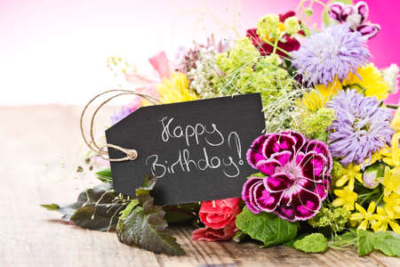 magenta decor: a bouquet of flowers with a tag saying: Happy Birthday