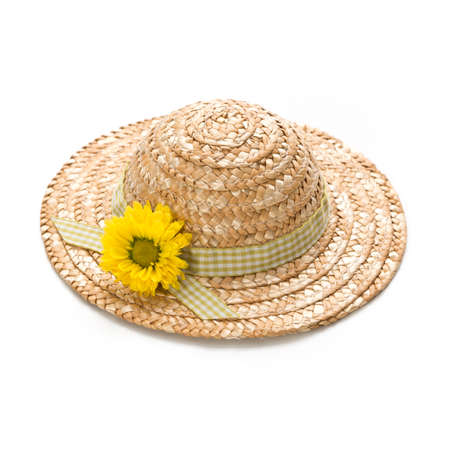 a straw hat with a flower, isolated