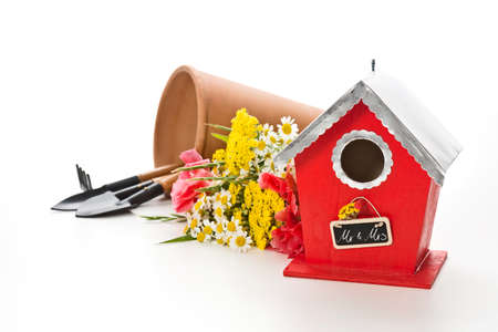 mr and mrs: a birdhouse with flowers and gardening tools on white background and a tag: Mr. & Mrs. Stock Photo