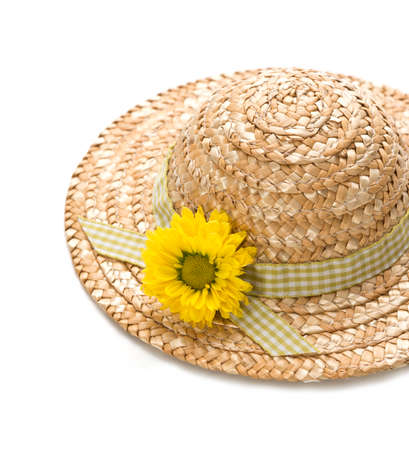 chapeau paille: a straw hat with a flower, isolated