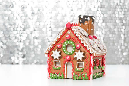 silver: home made gingerbread house with a silver bokeh background