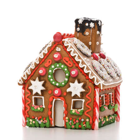 home made gingerbread house with white background